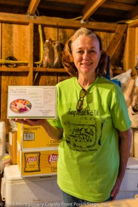 2010 Possum Queen and Queen of the Back Porch Kitchen, Jane Babbitt, shows off one of the box lunches prepared by the team, led by Honorary Possum Queen Janet Z. Capua. The best chicken salad you've ever had!