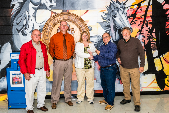 Presenting a $1000 donation to Cillia Green of the Caddo Hills School Music Program.