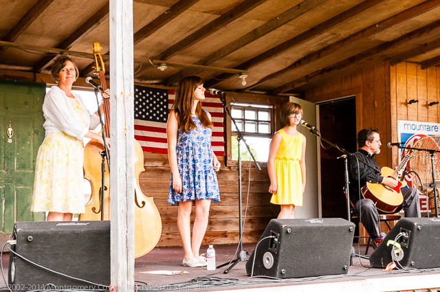 Cindy Clark, Sophie Clark, Sally Clark, and Bill Nesbitt on the Front Porch Stage.