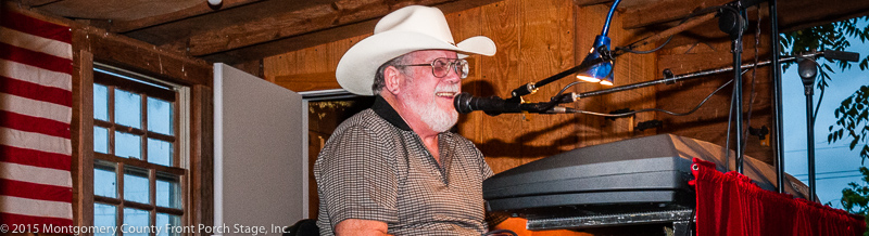 Dewayne always plays with a big smilie on his face. A great musician! This photo is from Dewayne's 2014 visit to the Front Porch Stage.