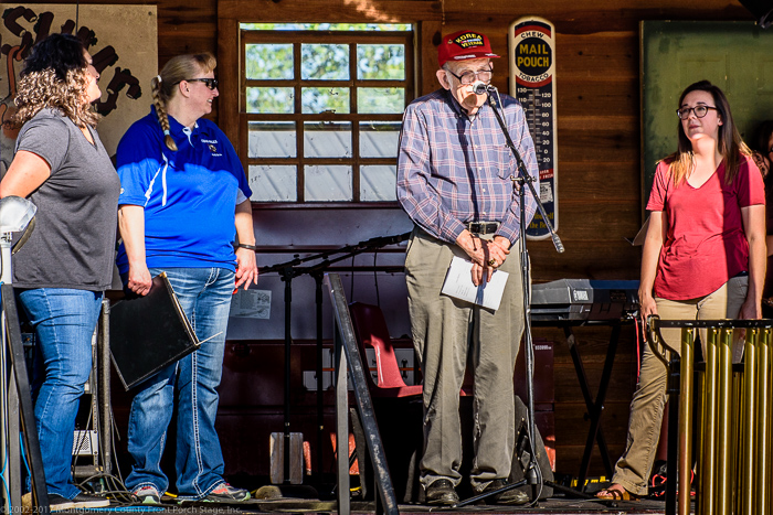"""Possum Potentate"" John Henderson introduces our high school music directors:  Jessica McAnulty (Oden), Cilla Green (Caddo Hills), and Christa Burgess (Mount Ida). We sincerely thank these teachers for the work they are doing.<br />(Click on this image to view photos from the 2017 Spring Band Bash.)"
